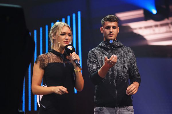 LONDON, ENGLAND - AUGUST 18:  Alvaro Morata of Chelsea tosses the coin with presenter Laura Woods during day three of the FIFA Interactive World Cup 2017 Grand Final at Central Hall Westminster on August 18, 2017 in London, England.  (Photo by Ben Hoskins - FIFA/FIFA via Getty Images) *** Local Caption *** Alvaro Morata;Laura Woods
