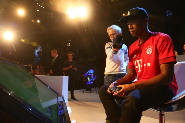 MUNICH, GERMANY - MAY 19:  FIFA Interactive World Cup 2015 winners Abdulaziz Alshehri of Saudi Arabia plays a fun match against  David Alaba of FC Bayern Muenchen after the finale for FIFA Interactive World Cup 2015 at Volkstheater on May 19, 2015 in Munich, Germany.  (Photo by Alexander Hassenstein - FIFA/FIFA via Getty Images) *** Local Caption *** David Alaba